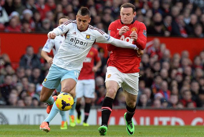 Ravel Morrison shrugs off Manchester United's Wayne Rooney whilst playing for West Ham